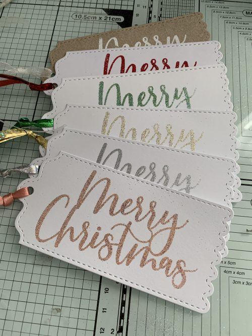 6 mixed colour tags with Merry Christmas